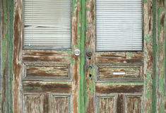 Old Green Door. A wooden double door with peeling green paint Royalty Free Stock Photography
