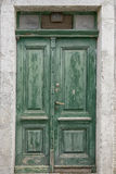 Old green double doors. With windows Stock Photo