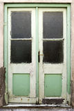 Old green double doors Stock Images