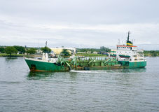 Green dredge Stock Images
