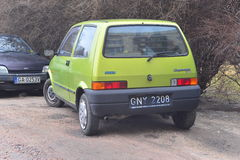 Old green Fiat Cinquecento parked Stock Images