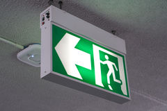 Old Green fire exit sign at hotel Royalty Free Stock Images