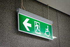 Old Green fire exit sign at hotel Stock Images