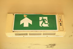 Old Green fire exit sign Stock Photo