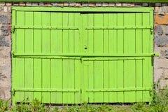 Old green garage door Stock Images