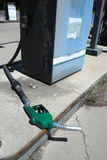Old Green Gas Pump Handle Laying on Ground Stock Photos