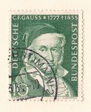 An old green german stamp with an image of Johann Carl Friedrich Gauss the mathematician and physicist. Leeds, England - May 28 2018: An old red east german Stock Photography