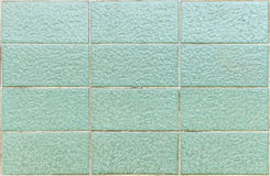 Old green grunge square tile background Stock Images