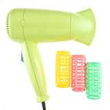 Old green hairdryer and colorful curler isolated Royalty Free Stock Image