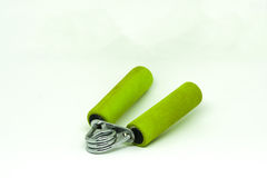 Old green hand grip equipment for hand massage and exercise. Royalty Free Stock Photos