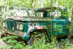 Old Green Jeep in Woods. DETROIT, MICHIGAN - May 11, 2015: Jeep is a brand of American automobiles. The former Chrysler Corporation acquired the Jeep brand Stock Photo