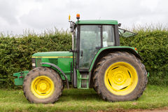 A old green  john deere 6450 tractor Stock Image