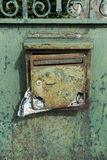 Old Green Mailbox with Mail Stock Photo