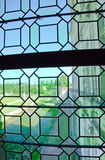 Old green medieval glass of window Stock Photos
