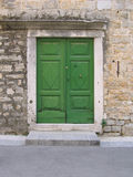 Old green mediterranean doors. Green door of old mediterranean stone house in Croatia Stock Photo