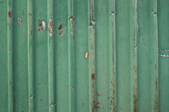 Old green metal fence. Background stock images