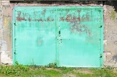 Old green metal garage door Stock Image