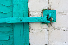 Old green metal window latch Stock Photo