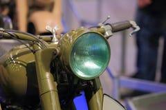 Old green motorcycle closeup Royalty Free Stock Photo