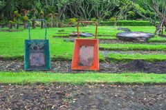 Old green and orange construction trolley located on brown ground to carry soil and fertilizer for gardening. Old green and orange construction trolley located Royalty Free Stock Photo