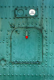 Old green painted aircraft hatch. Royalty Free Stock Photos