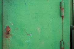 Old green painted door.Place for text. Background image. Texture iron painted door with scratches and rust Royalty Free Stock Photos