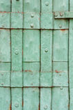 Old green painted riveted metal door detail Royalty Free Stock Images