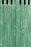 Old green painted weathered wooden planks Stock Photo