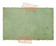 Old green paper sheet with tape isolated on white Stock Image
