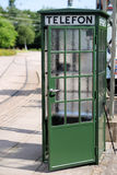Old green phone booth Stock Photos