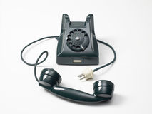 Old green phone on a white background. Old green phone to wheel on a white background Royalty Free Stock Photo