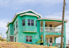 Old Green Plaster Home in the Tropics Royalty Free Stock Photo