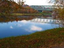 Old green railway bridge across the river stock photo