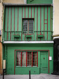 Old green and red building in Paris, France. Old wooden green and red building in Paris, France Stock Image