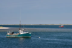 Old green and red fishing boats anchored in calm w Royalty Free Stock Photo