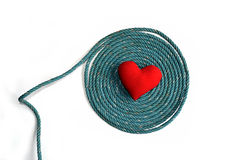 Old green rope and red heart isolate on white background Stock Photo