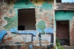 Old green ruined house. Detail of old green ruined house without door and window Royalty Free Stock Photography