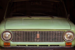 Old green russian car front gille light reflections Stock Photography