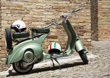 Old Green Scooter, Vespa. Retro scooter Vespa on the street in Italy Stock Photo