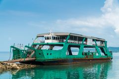 Old sea ferry. Old green sea ferry at the pier. Sometimes ferry is the only transportation between islands Royalty Free Stock Photo