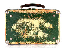 Old green shabby suitcase Stock Images