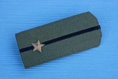 Old green shoulder strap with big star. Old Soviet green shoulder strap with a big star royalty free stock image