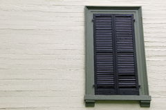 Old green shuttered window Royalty Free Stock Photo
