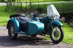 Old green soviet motorcycle Stock Photos