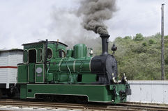 Old green steam train in Holland Stock Photo