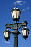 old green street lamp and clouds Royalty Free Stock Photography