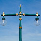 An old green streetlamp in a rural Royalty Free Stock Images