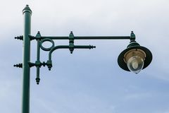 An old green streetlamp in a rural Royalty Free Stock Photo