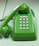 Old green telephone Stock Image