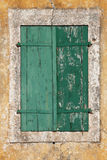 Old green textured shutters Stock Image